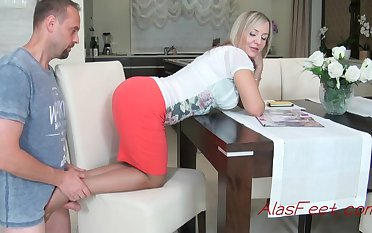 Glamorous blond cougar is getting down on all fours on the stool, while providing a excellent footjob to her colleague
